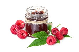 Raspberries jam in glass jar