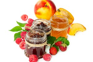 Jam in glass jars and berries