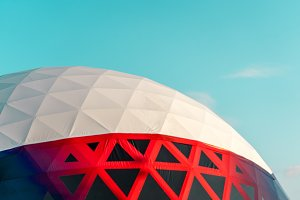 White with red dome pavilion on a turquoise sky background