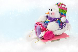 Toy snowman on a sled