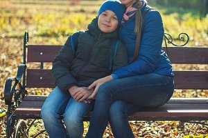 Mother and son at autumn park