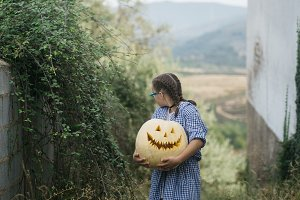 little girl with the pumpkin outdoor