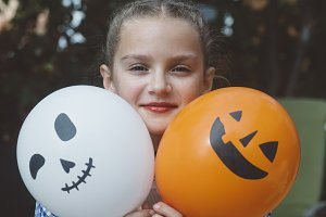 girl with drawn pumpkin balloon