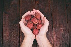 Men's hands with lychee