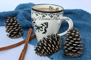 Cup of coffee, pinecones, & cinnamon