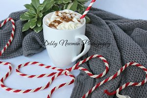 Cup of cocoa, sweater & red cord