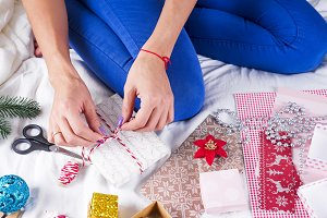 Closeup image of mother making Christmas present