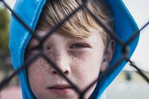 Boy Behind Fence
