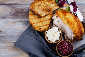 Ingredients for homemade turkey leftover sandwich with cranberry sauce