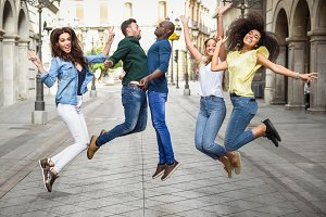 Multiracial friends jumping