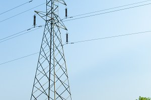 high voltage pylons in rice fields.