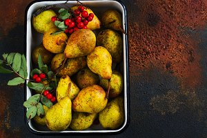 Autumn harvest concept. Fall ripe pears on grunge background