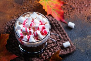 Hot peppermint chocolate with marshmallows and raspberry syrup