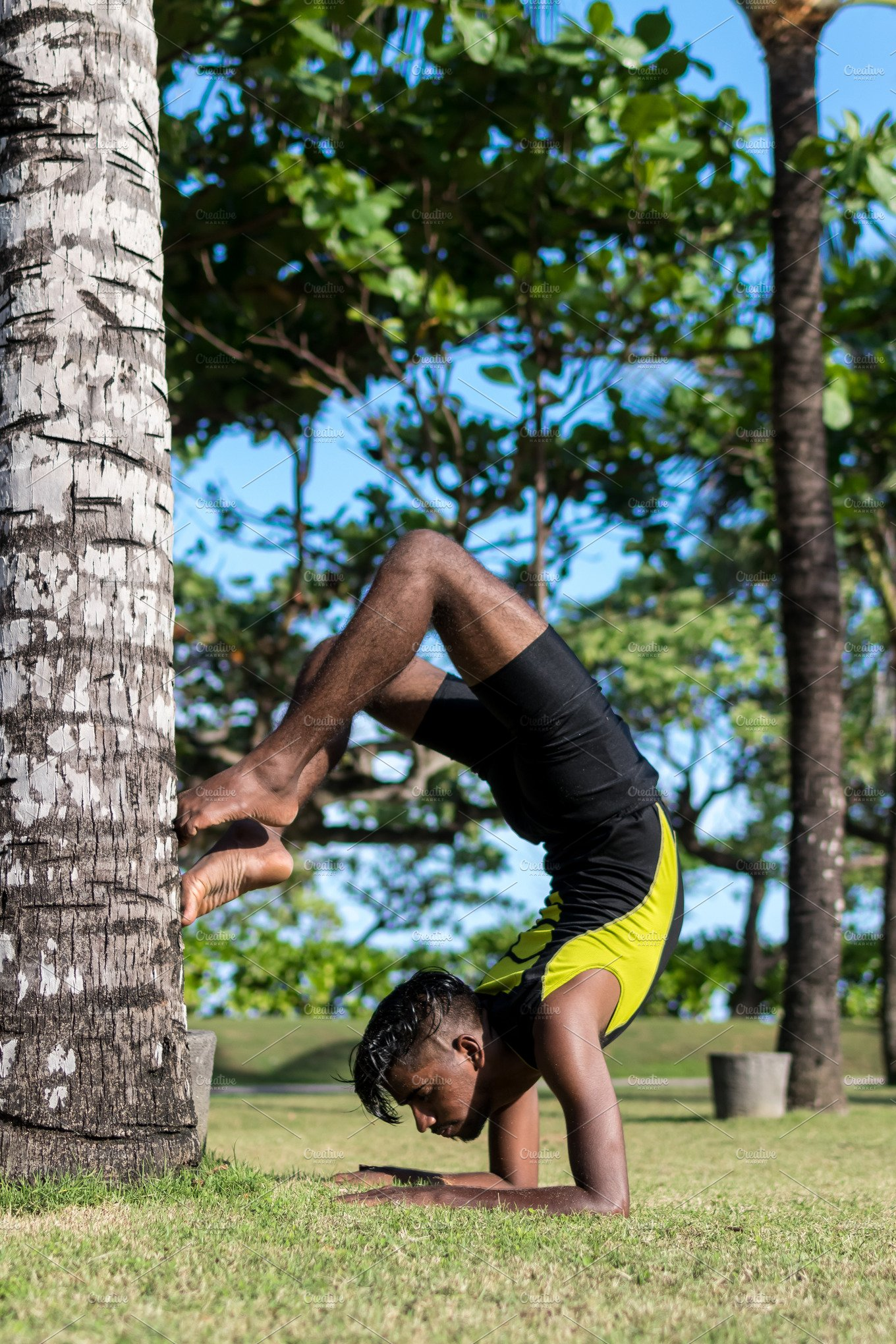 Young Yoga Man Practitioners Doing Yoga On Nature Asian Indian Yogis Man On The Grass In The Park Bali Island High Quality Sports Stock Photos Creative Market