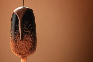 chocolate ice cream on a stick and liquid chocolate covered it. Different chocolate textures