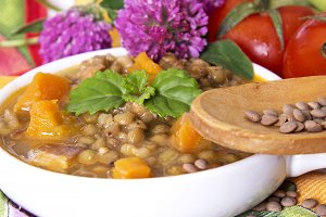 Lentil casserole with wooden spoon