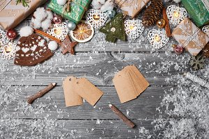 Christmas decorations and pine cones on gray wooden table. Christmas background. Space for text. Top view.