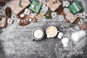 Christmas decorations on an old wooden table. Hot chocolate, cocoa with marshmallows and popcorn on wooden background.