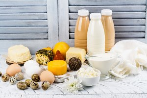 Assortment of dairy farm products on wooden table