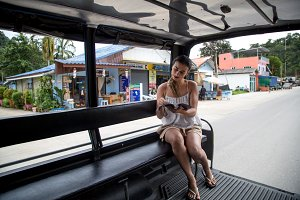 girl tourist in a Thai taxi
