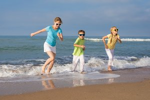 happy children running on the beach