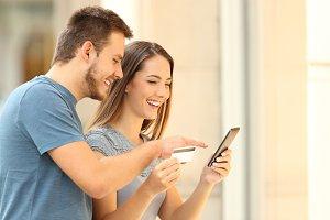 Happy couple buying on line