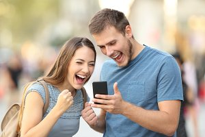 Excited couple receiving good news
