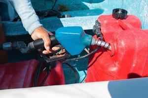 Man fueling tank of a motor boat bef