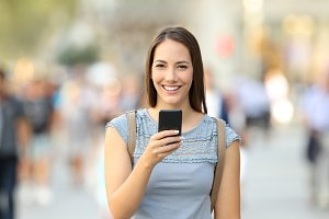 Happy woman holding a smart phone