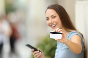 On line buyer showing a credit card
