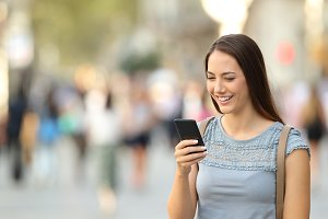 Happy lady using a smart phone