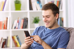 Happy guy using a smart phone