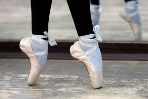 Close up view to ballerinas legs in