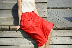 Happy blonde girl red skirt smile