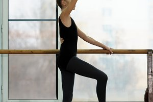 Young ballet dancer exercising at th