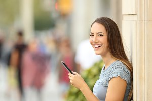 Smart phone user looking at camera