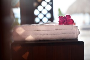 Pile of three white clean towels wit