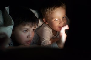 Two boys watching movie on ipad