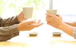 Two women hands talking