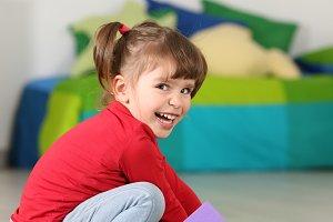 Little toddler girl smiling