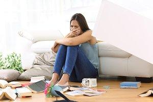 Sad homeowner lamenting