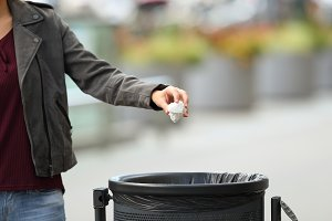 Lady hand throwing garbage