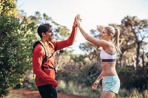Athletic couple  celebrating