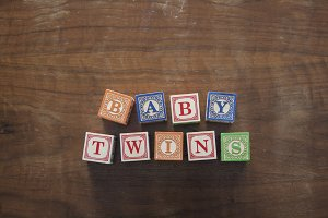 Baby twins in wooden blocks