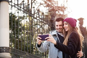couple taking selfie in the street