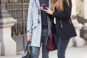 couple using phone in street