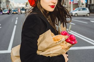 French woman in beret with baguettes