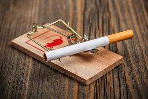 Cigarette in a mousetrap