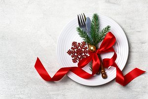 Christmas table setting with christmas decorations ribbon bow snowflake and ball