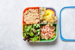 lunch box with a balanced meal. Fruits Vegetables Proteins